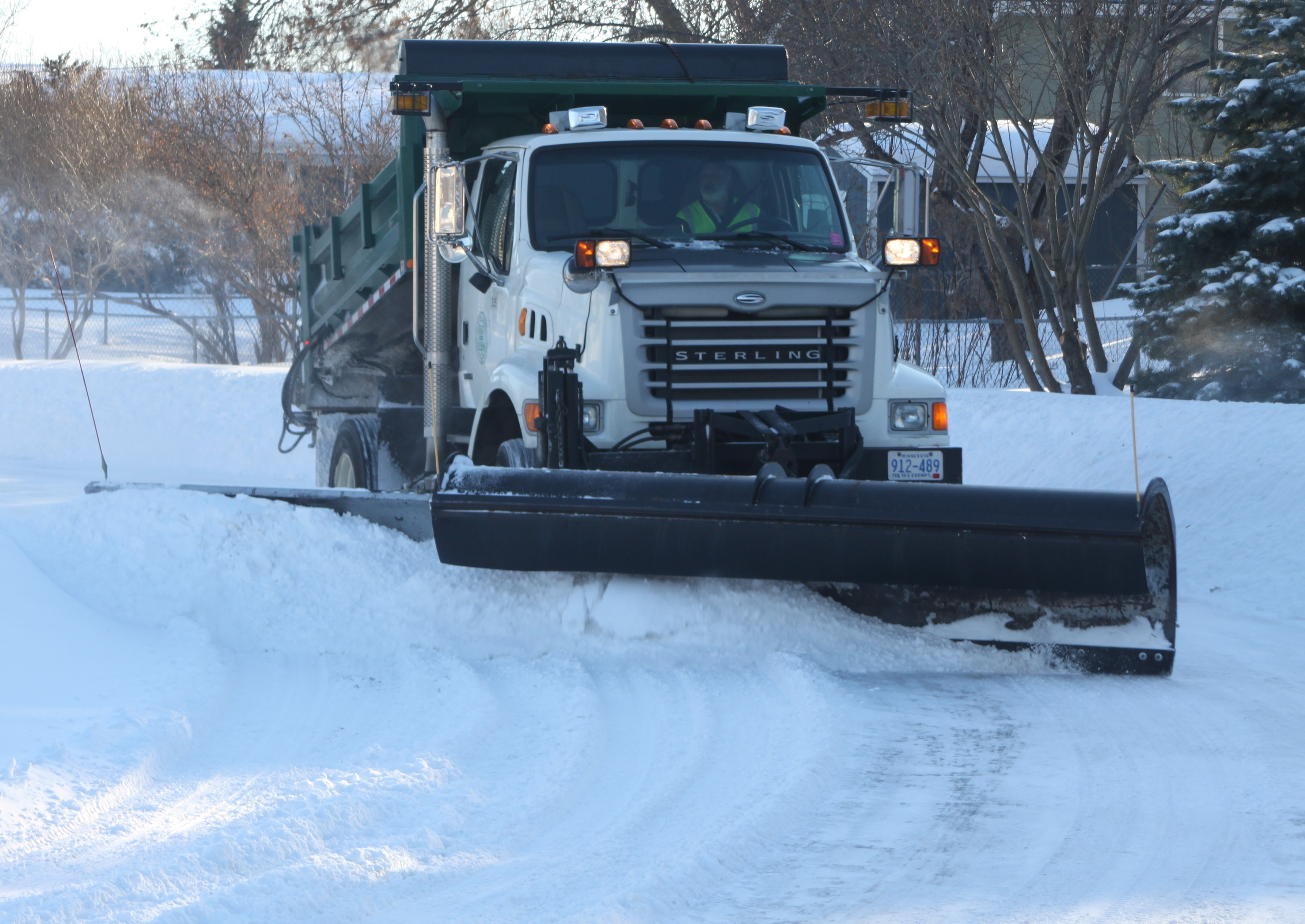Severe damage is caused when snow plow blades dig in along the edges of the lawn.