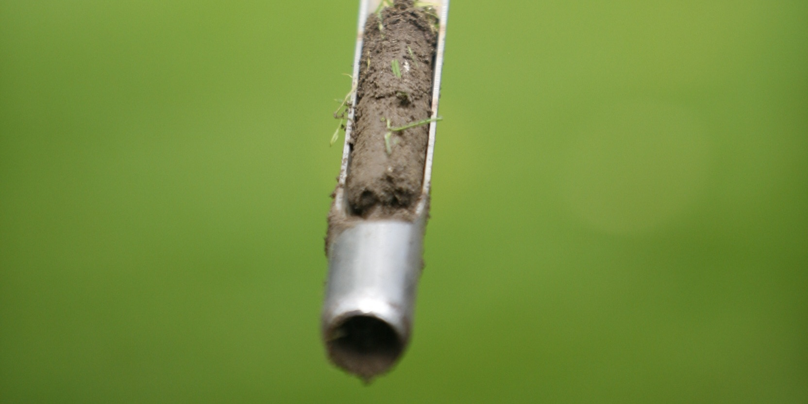 A soil probe is a device that you can manually push into your soil several inches deep to extract a small core sample, similar in size to your index finger.
